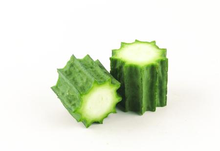 ridged: Fresh Angled luffa fruits isolated on white background Stock Photo
