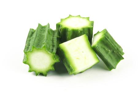 angled: Fresh Angled luffa fruits isolated on white background Stock Photo