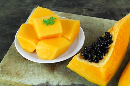 cutaneous: slice of sweet ripe papaya on white background