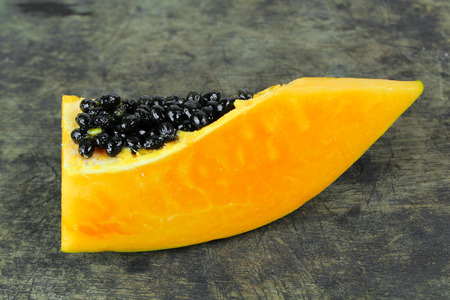 cutaneous: slice of sweet ripe papaya on white background