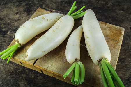 fresh slices white radish on wooden background, healthy vegatable