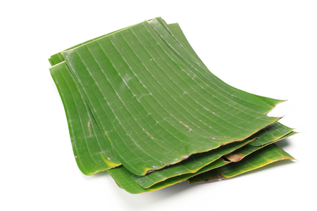 original ecological: Banana leaves for wrapping or serving food as ecological dishware, isolated on white Stock Photo
