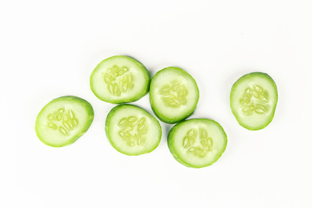 ration: fresh sliced cucumber on white background, raw organic vegetable Stock Photo