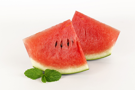 red watermelon whole and slice on plate with mint leaf Stock Photo