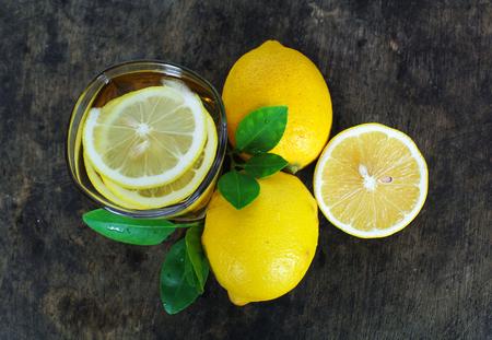 fresh lemon whole and slice with lemon leaf