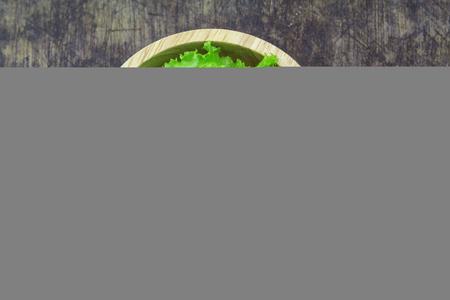 Salad leaf. Lettuce isolated on wooden background