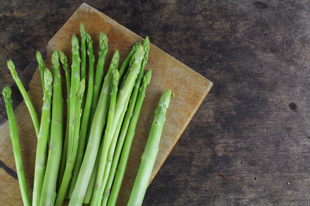 nutritiously: Green asparagus on a wooden background Stock Photo