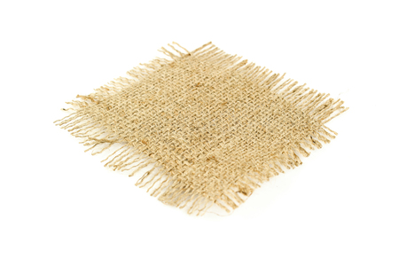 Hessian sack tied with string from low perspective isolated against white background Stock Photo