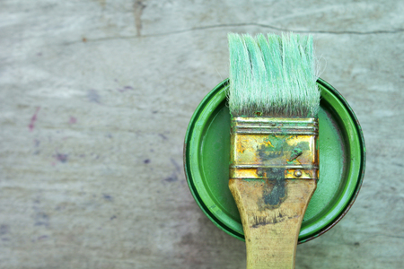 redecorating: paint can and paint brush on the grunge wooden background Stock Photo