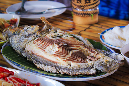 Grilled Tilapia fish on plate at restaurant