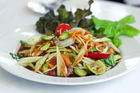 Fresh papaya salad with shrimp and carrot garnish with salad leaf Stock Photo