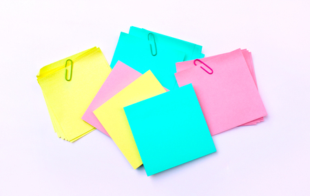 yellow, pink, blue sticky note isolate on white background