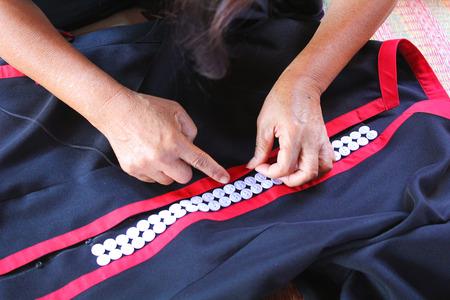 Women are sewing, tribal dress, Phuthai dress