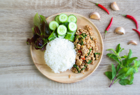 Thai spicy food, Fried pork with sweet basil Фото со стока