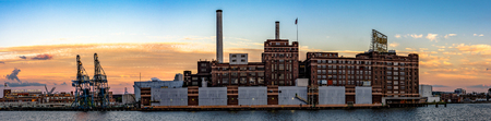 Baltimore, Maryland, USA - July 8, 2017: A panoramic view of the Domino Sugar refinery, the last manufacturing plant on the Inner Harbor. In operation since 1922, the refinery is a state-of-the-art facility that has the second highest sugar production cap Editorial