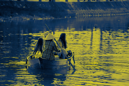 Hoi An, Vietnam - January 29, 2017 - Tourist can hire a traditional boat ride in Hoi An ancient town to enjoy a different view point and scenic view. Editorial