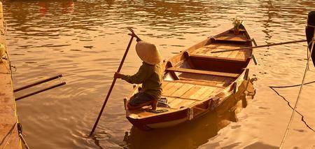 paddler: Hoi An, Vietnam, Boat man paddler in the golden hour