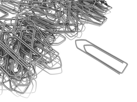 bureaucracy: Messy heap of silver paper clips isolated on a white background, referring to concepts such as office equipment, work, administration and bureaucracy, as well as document filing