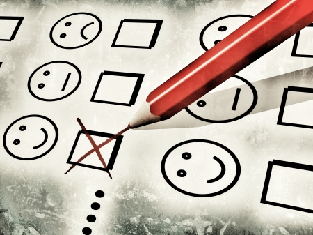 grunge-style illustration of a red pencil used to fill a customer satisfaction form, with notches on checkboxes with smileys, referring to concepts such as customer satisfaction survey and evaluations Stock Photo