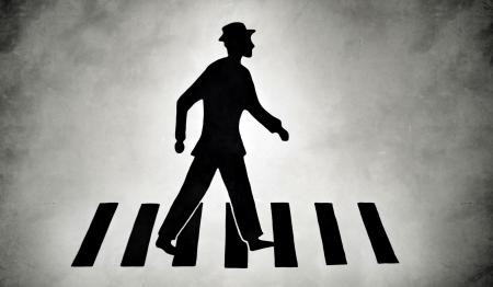 zebra crossing: Silhouette of a pedestrian on zebra crossing street