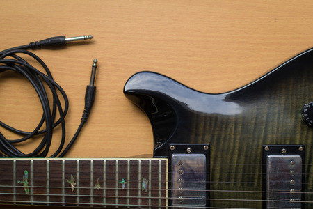 mojo: Electric guitar on on wood