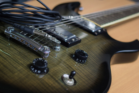 Electric guitar on on wood