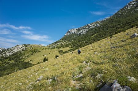 Hiking in Paklenica Velebit Mountain in Croatia Europe. Beautiful nature and landscape. Summer day blue sky Stock Photo