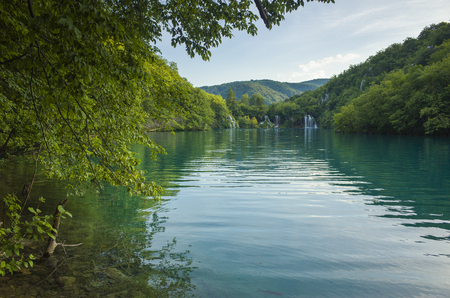 Plitvice Lakes Croatia Europe. Beautiful nature and landscape photo. Nice warm summer day. Lovely outdoors image with lake, trees and waterfalls. Joyful and happy picture. Stock Photo