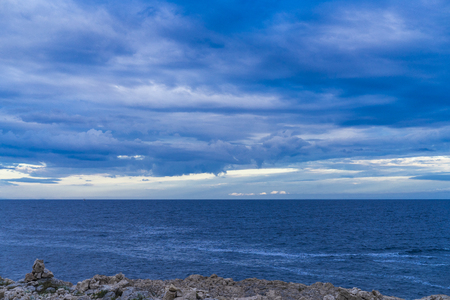 Adriatic Sea Croatia Europe. Beautiful nature and landscape photo of ocean and cloudy sky at spring dusk evening. Nice outdoors image with lovely blue color tones. Calm and peaceful picture. Stock Photo