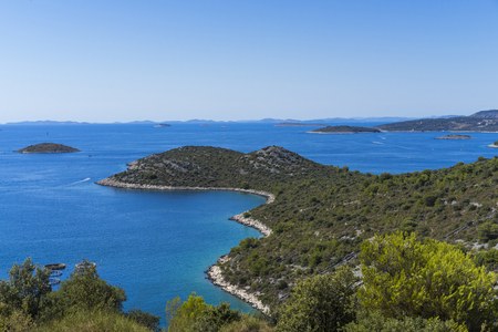 Beautiful nature and landscape photo of Croatia and Adriatic Sea. Nice, warm summer day with clear blue sky and lovely ocean. Calm, joyful and happy image.