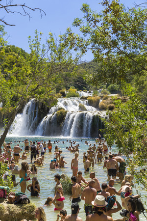 Krka National Park, Croatia, August 14 2017, People swimming in water close waterfall, Nice warm summer day. Editorial
