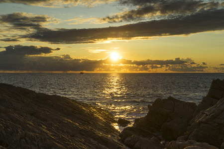 poetic: Sunset at Adriatic Sea in Razanj Croatia. Beautiful nature and landscape photo of warm summer evening in Dalmatia. Sun and reflection in water. Nice, calm and peaceful picture. Happy and joyful image.