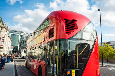 London Great Britain, October 12 2017, Red bus in the city, Nice sunny autumn day with blue sky Editorial