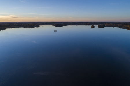 Beautiful sunset in Katrineholm, Sweden, Scandinavia. Lovely nature and landscape on autumn evening. Nice outdoors photo shot with drone in sky from above. Calm, peaceful, stillness and joyful. Stock Photo