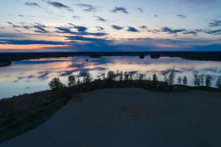 Beautiful nature and landscape photo of sunset in Katrineholm Sweden. Nice, calm and peaceful spring evening in Scandinavia. Picture shot with drone. 免版税图像