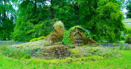 wraith: The shape of two faces in the grass on the island of Mainau in the center of Europe. Stock Photo