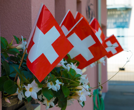 Swiss flags on the houses for the celebration of the Independence Day on August 1.