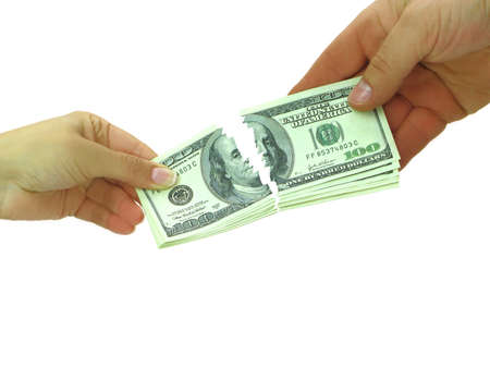 economic rent: Couple breaking money after divorce or breaking contract  Stock Photo