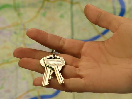 Female hand holding key in front of a Shanghai map Editorial