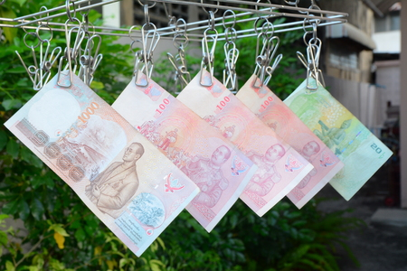 paper hanger: Money paper hanged by cloth hanger Stock Photo