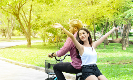 hapiness: Lover with happy time on their bike