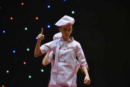 Young teenage girl in chefs cook's uniform 스톡 콘텐츠