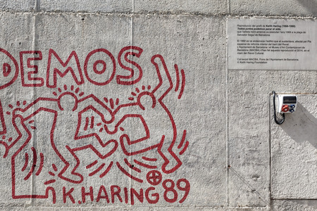 keith: BARCELONA,SPAIN-SEPTEMBER 20,2015: Detail of reproduction of paint by Keith Haring painted in 1989. Exterior, in  a wall close to museum MACBA, Raval quarter, Barcelona.
