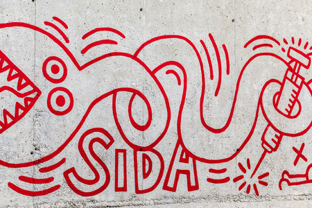 keith: BARCELONA,SPAIN-DECEMBER 26,2015: Detail of reproduction of paint by Keith Haring painted in 1989. Exterior, in  a wall close to museum MACBA, Raval quarter, Barcelona.