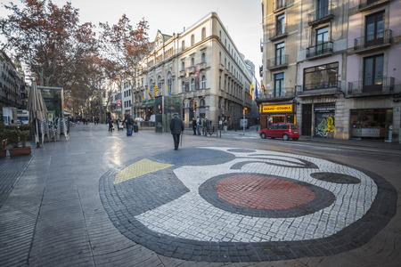 BARCELONA,SPAIN-DECEMBER 30,2015: La Rambla, mosaic in pavement, by Joan Miro, located in Pla de la Boqueria, Barcelona.