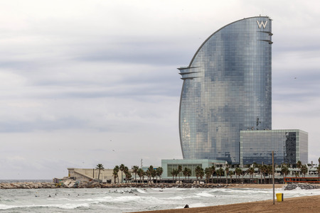 BARCELONA,SPAIN-SEPTEMBER 29,2015: Barceloneta beach and Modern architecture, Hotel W or Hotel Vela, by architect Ricard Bofill. Editorial