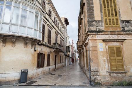 CIUTADELLA,SPAIN- JANUARY 22,2017: Narrow street and colored buildings,historic area,Menorca island,Balearic Islands.
