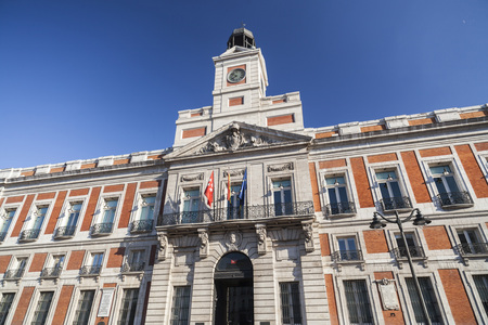 MADRID,SPAIN-JULY 21,2015: Architecture, House of the Post Office, Real Casa de Correos, office of the President of the Community of Madrid, square, Puerta del Sol, Madrid.