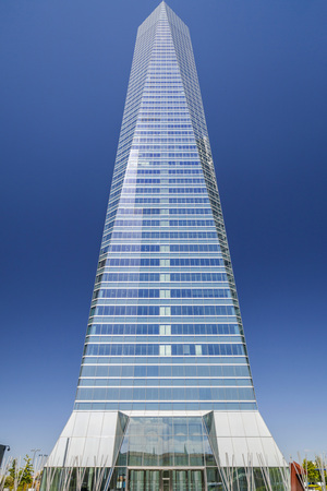 MADRID,SPAIN-JULY 21,2015: Contemporary architecture, skyscraper, tower of glass, Torre de Cristal in the Cuatro Torres Business Area, Madrid. Editorial