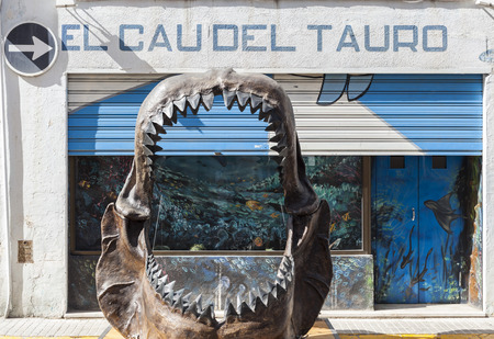 cau: ARBOS,SPAIN-AUGUST 22,2015: Big teeth of a shark in front museum El Cau del Tauro, only museum in Europe dedicated to the world of shark, Arbos, province Tarragona,Catalonia.